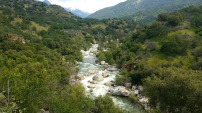 Kaweah River. It's flowing now! It trickled for years before this past winter's precipitation. The snowmelt in the Sierras will fuel its flow until August. Three Rivers, California is happy for the rafting business boom.